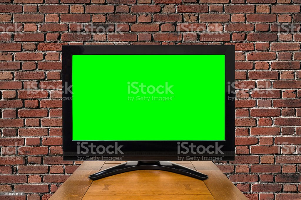 Modern Television with Chroma Green Screen and Brick Wall stock photo