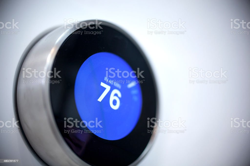 Modern thermostat stock photo