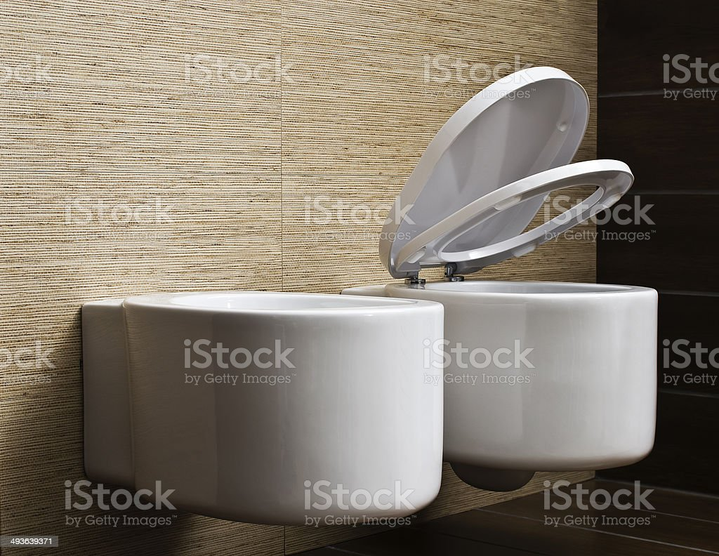 modern toilet with beige tile on wall stock photo
