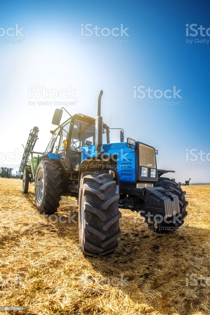 Modern tractor in the field on a sunny autumn day. stock photo