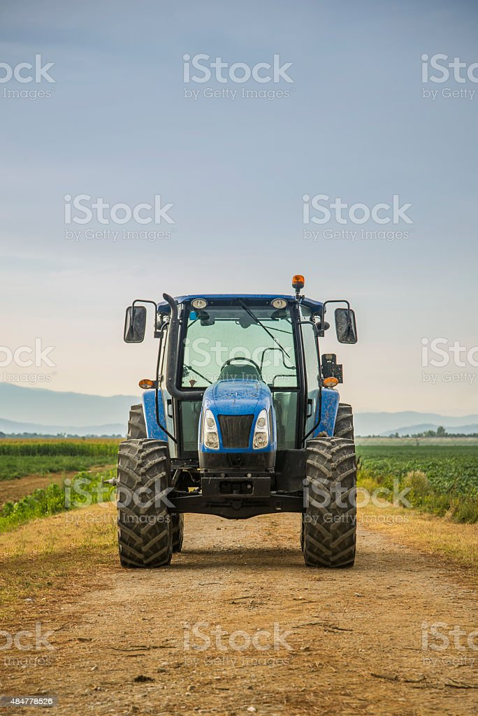 Modern tractor on field stock photo