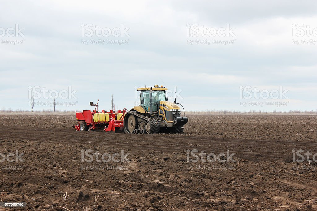 Modern tractor on soil treated cultivator in the field stock photo