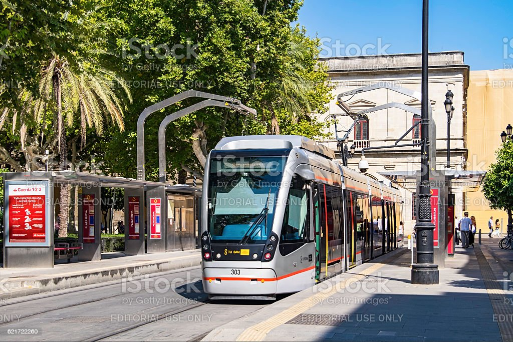Modern tram charging batteries in Seville historic town centre stock photo
