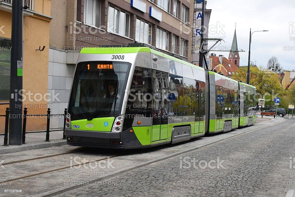 Modern tram in city centre stock photo