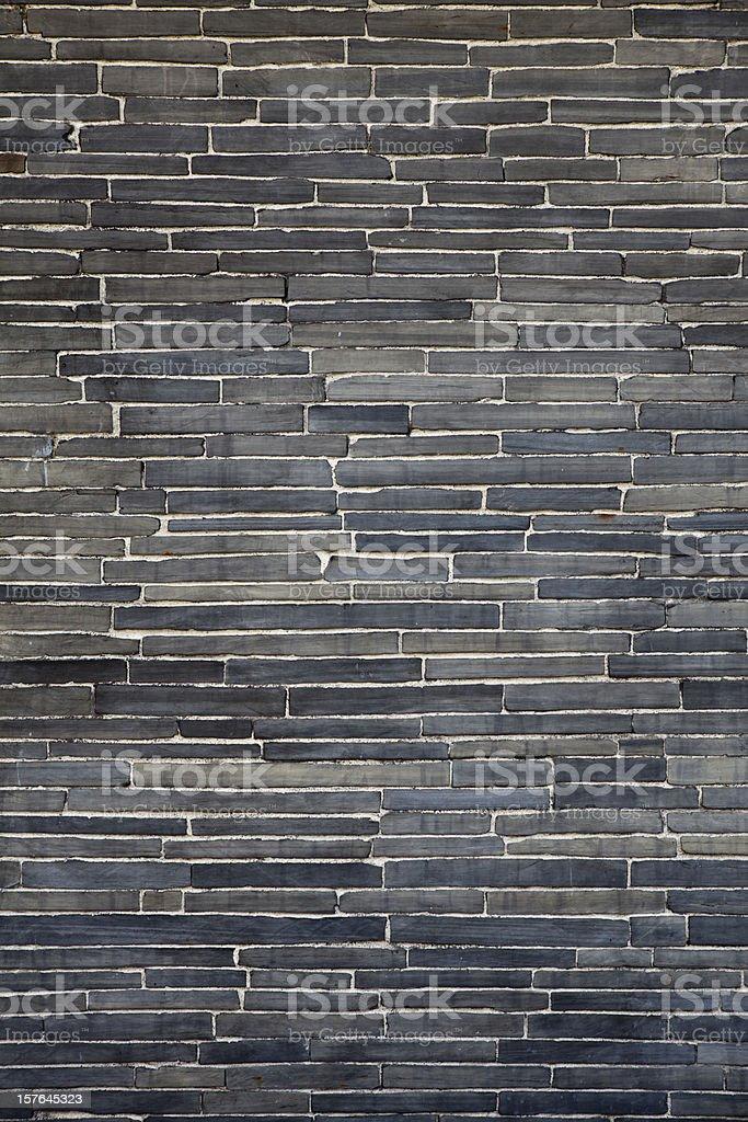 Modern trend,  black flagstone brick wall. royalty-free stock photo