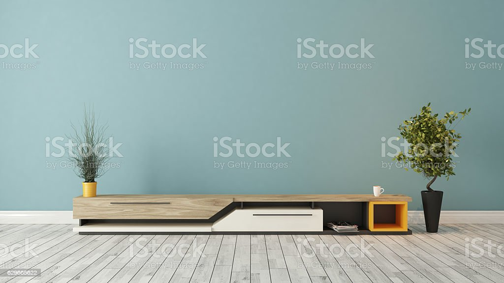 modern tv stand with blue wall design stock photo