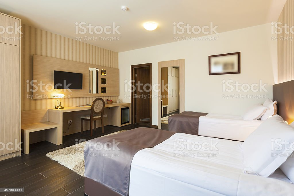 Modern twin bedroom interior stock photo