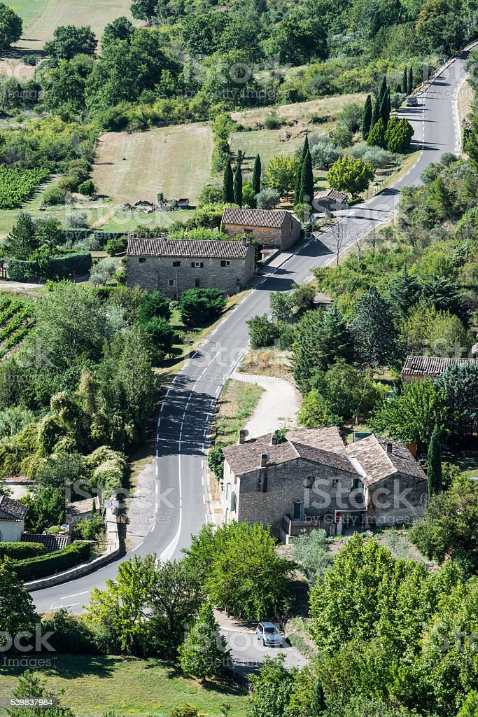 Modern twisted asphaltic road across a small village of Provence stock photo