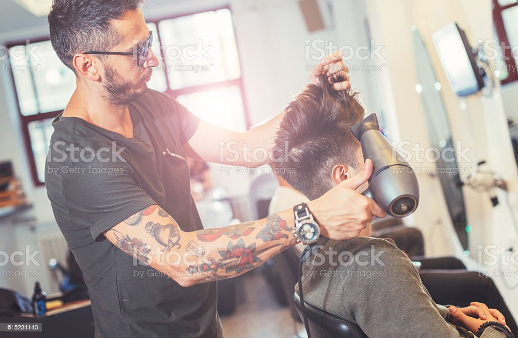 Modern undercut hairstyle stock photo