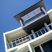 Modern unit complex building facade with blue sky
