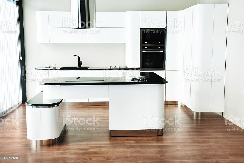 Modern, Upmarket, White and Stainless Steel Domestic Kitchen royalty-free stock photo