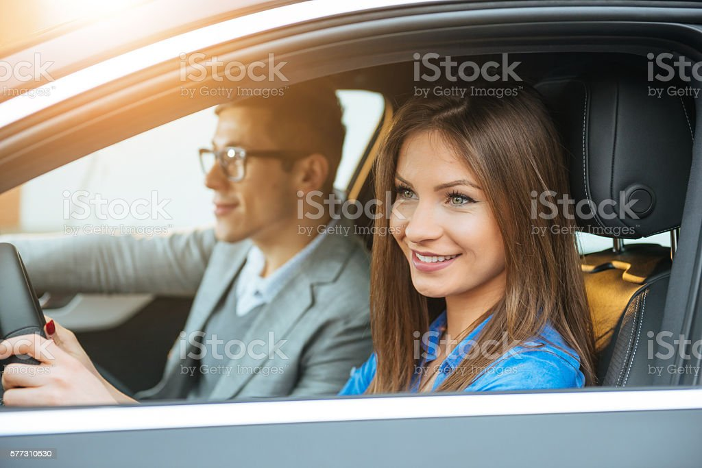 Modern urban couple traveling by car stock photo