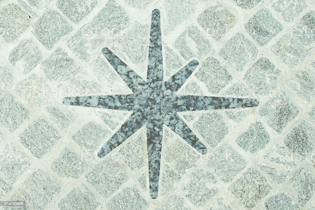 modern urban floor detail - porphyry compass stock photo