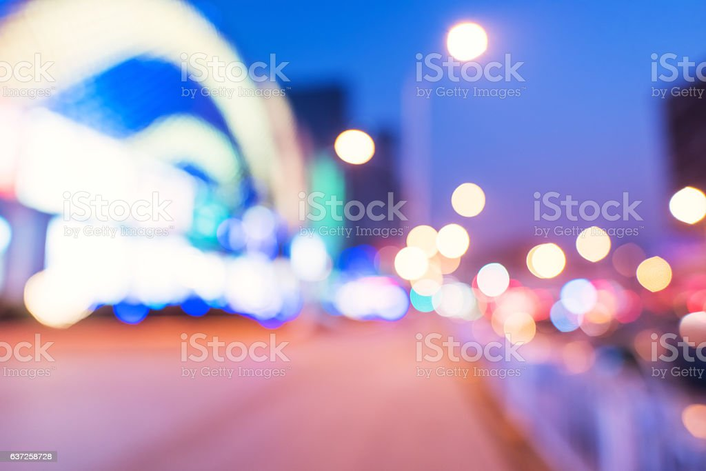 Modern urban night lights defocused abstract background stock photo