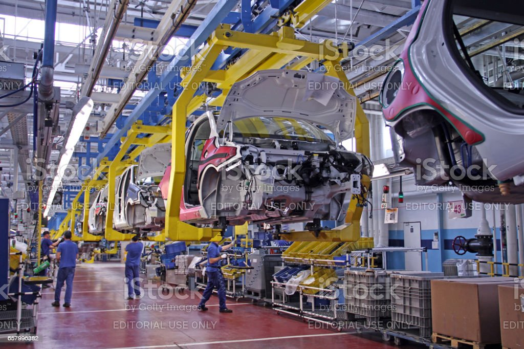 Modern vehicles on the production line stock photo