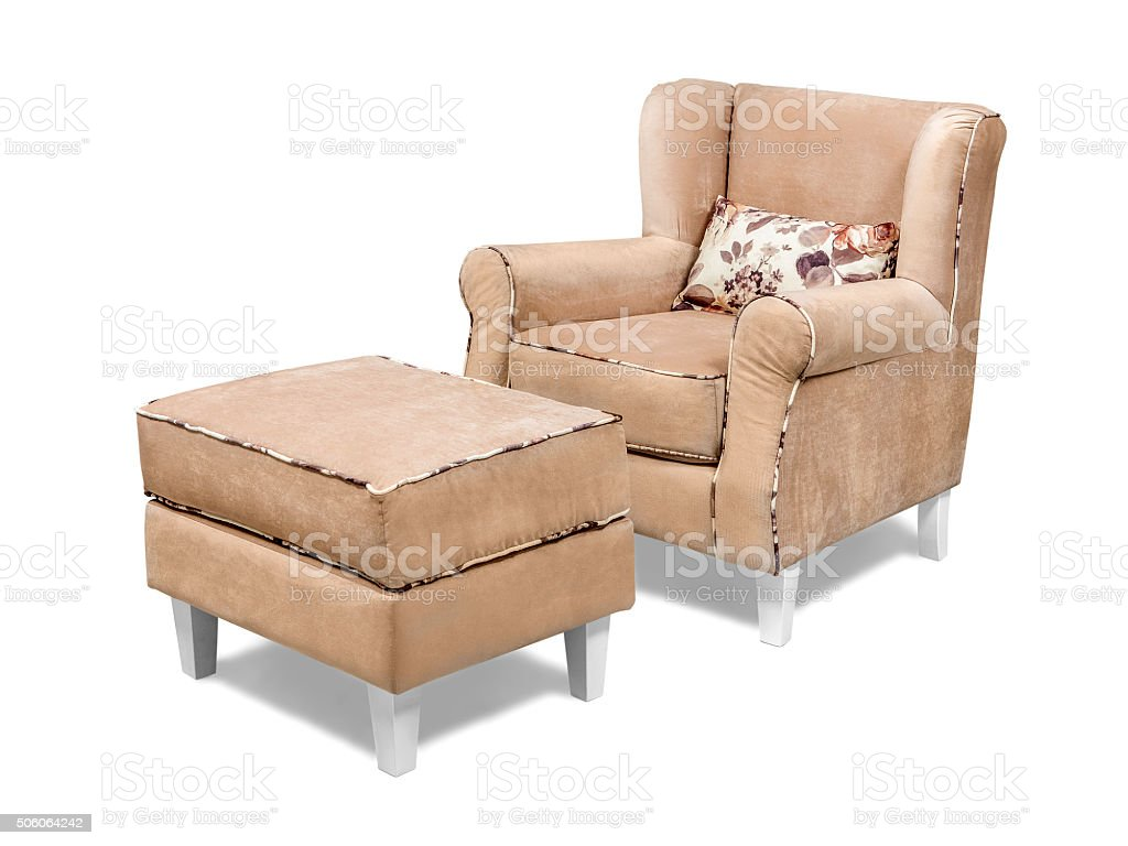 Modern velvet armchair with ottoman tabouret isolated with clipping path stock photo