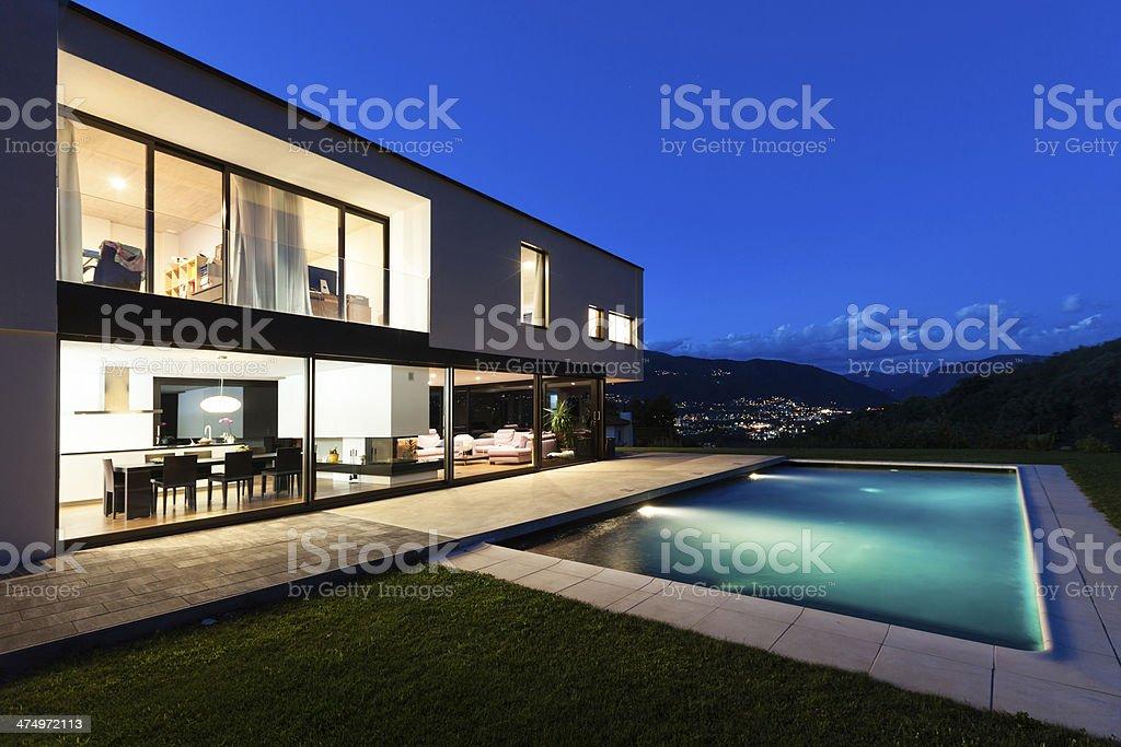 modern villa by night stock photo