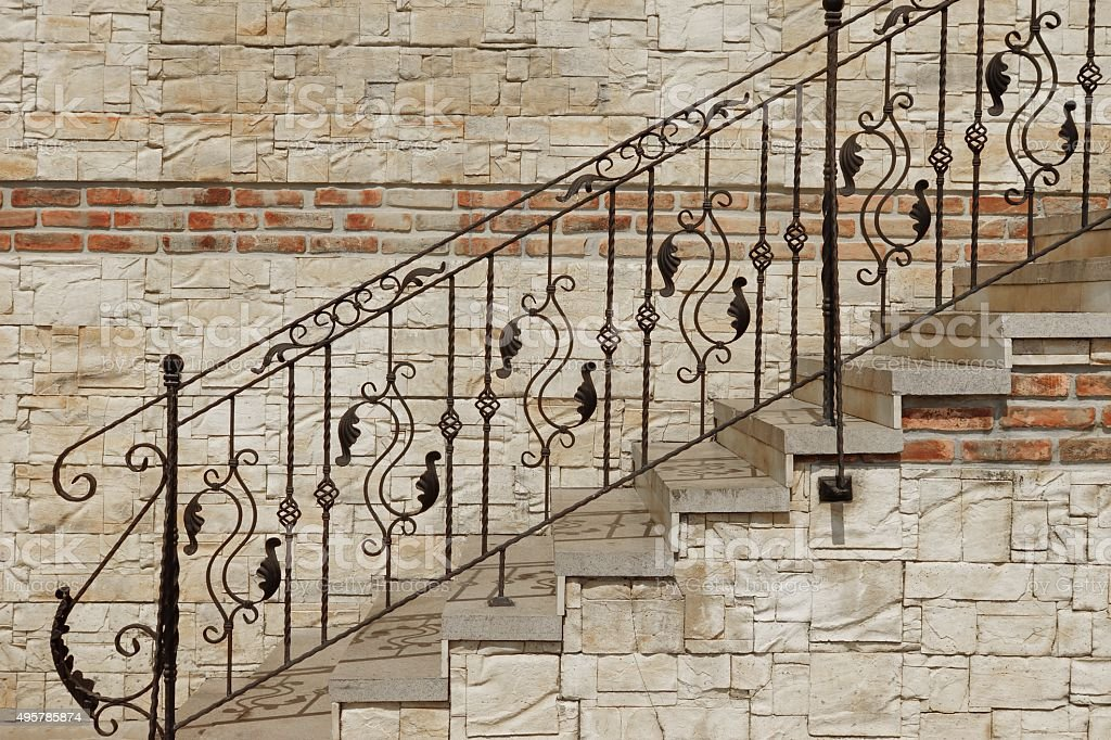 Modern Vintage Style Stone Staircase With  Wrought Iron Ornate H stock photo