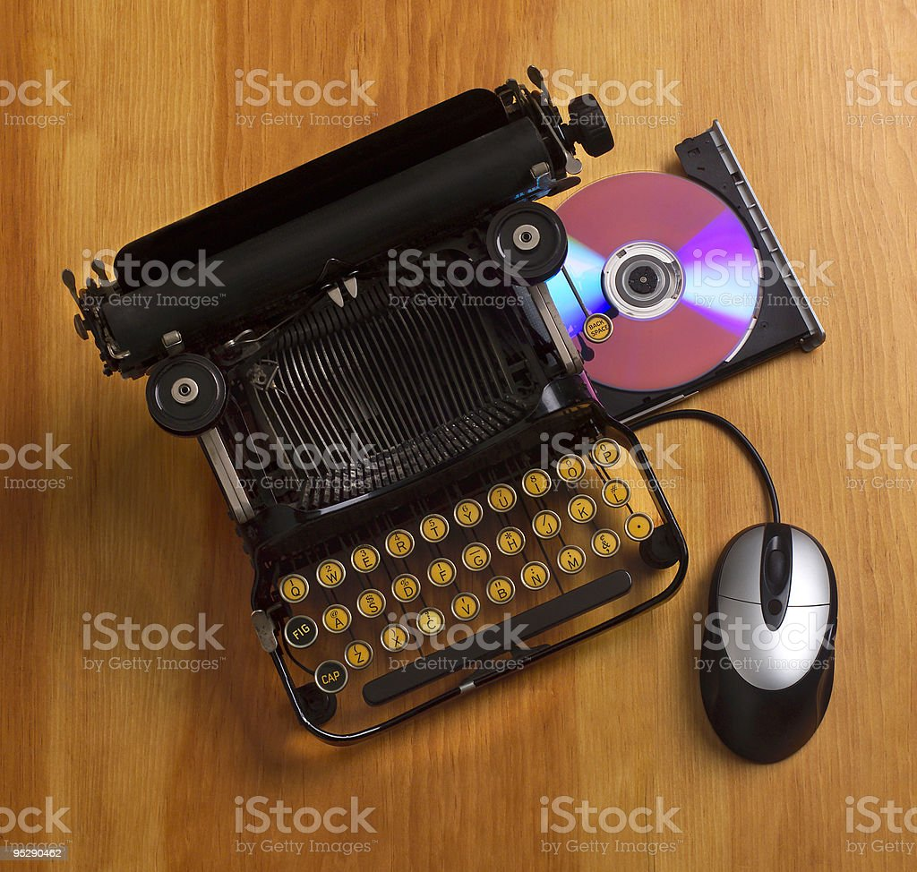 Modern vs Old World technologies; classic typewriter with cd drawer stock photo