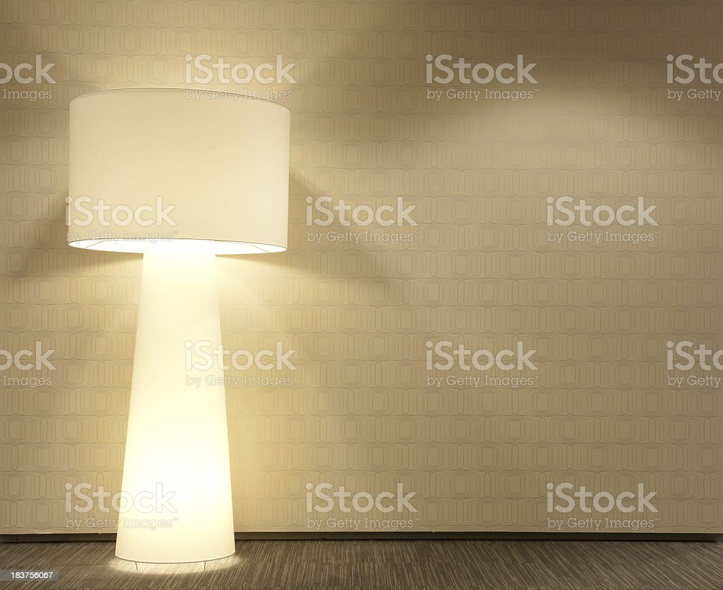 Modern wall with standing lamp royalty-free stock photo