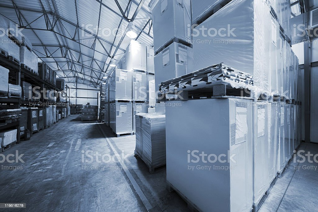 A modern warehouse full of boxes and shelves  royalty-free stock photo