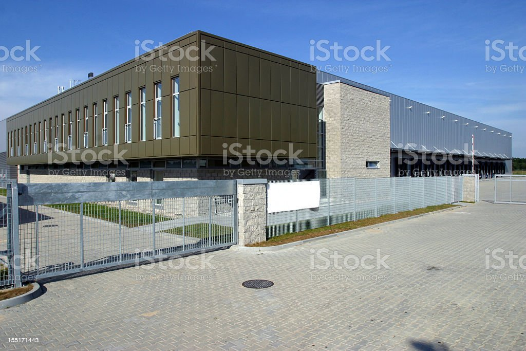 Modern warehouse with a gated entrance stock photo