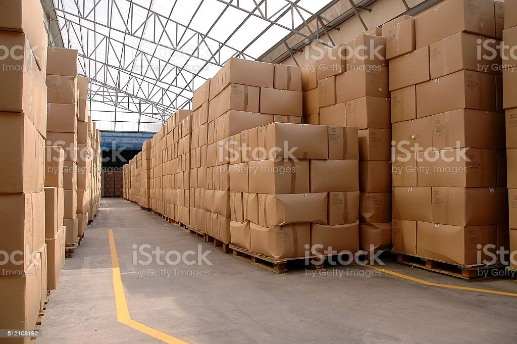 Modern warehouse with cardboard cartons stock photo