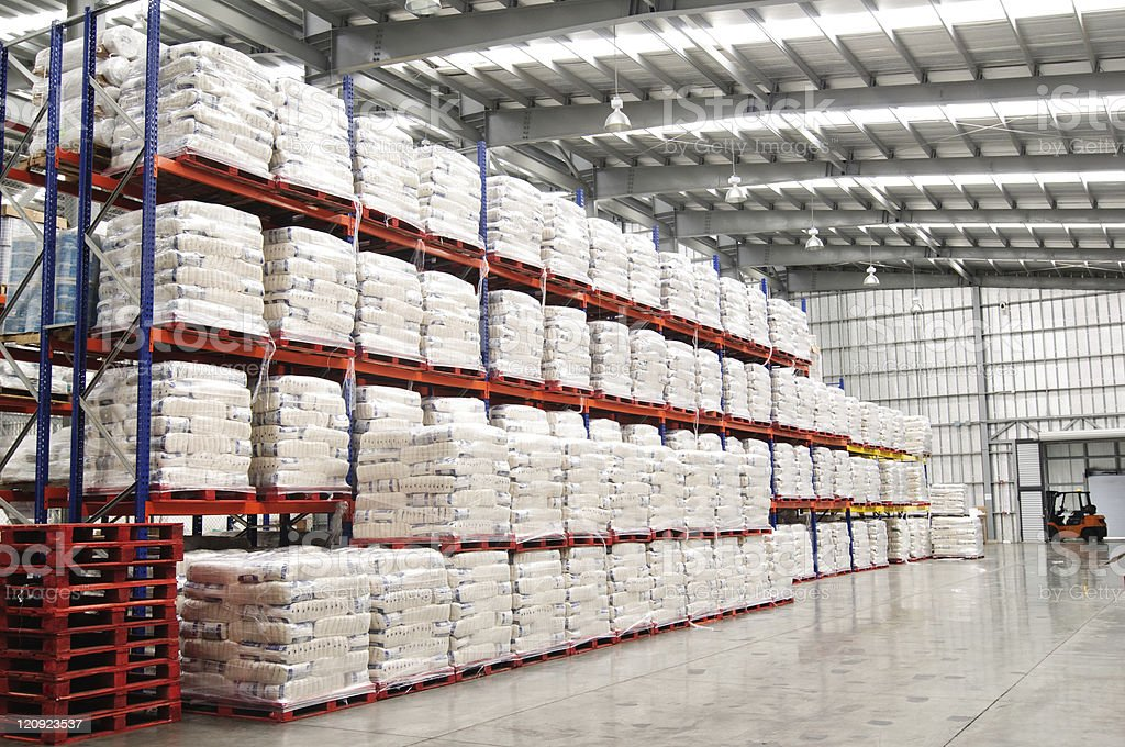Modern warehouse with shelves full of stacked goods. stock photo
