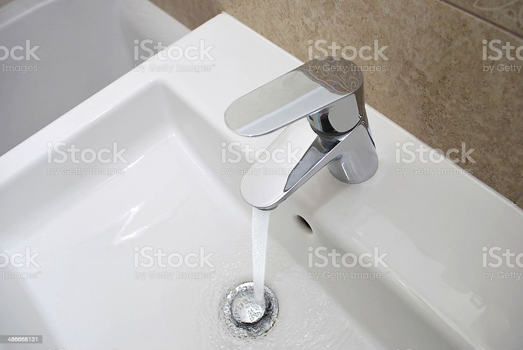 Modern water mixer tap stock photo