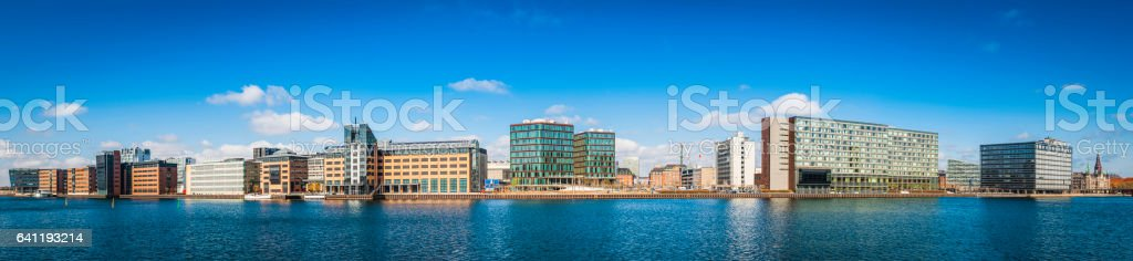 Modern waterfront cityscape panorama apartment buildings hotels offices Copenhagen Denmark stock photo