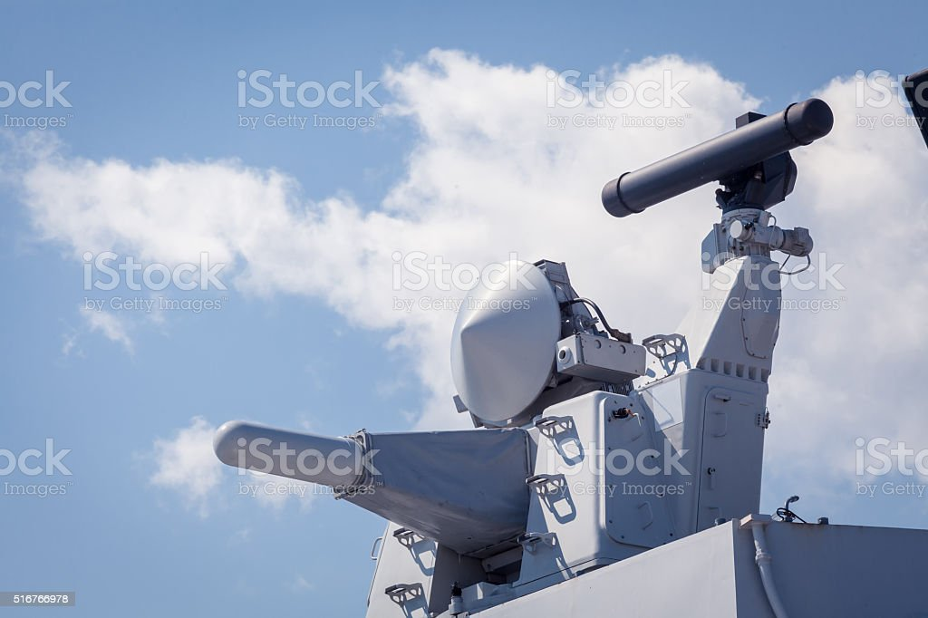 Modern weapons on the deck of military ship. System defense stock photo