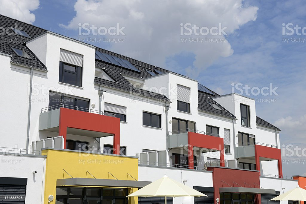Modern white apartment house with red balconies royalty-free stock photo