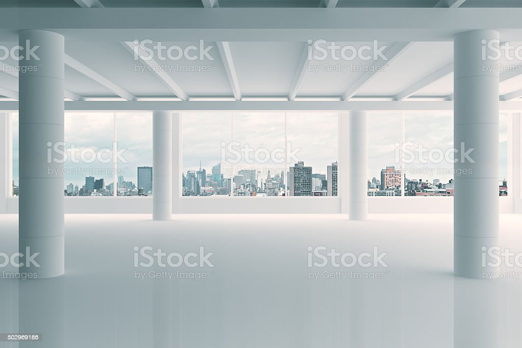 Modern white hangar area with city view stock photo