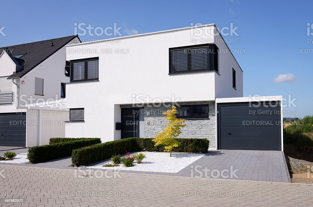 Modern white house with garage stock photo