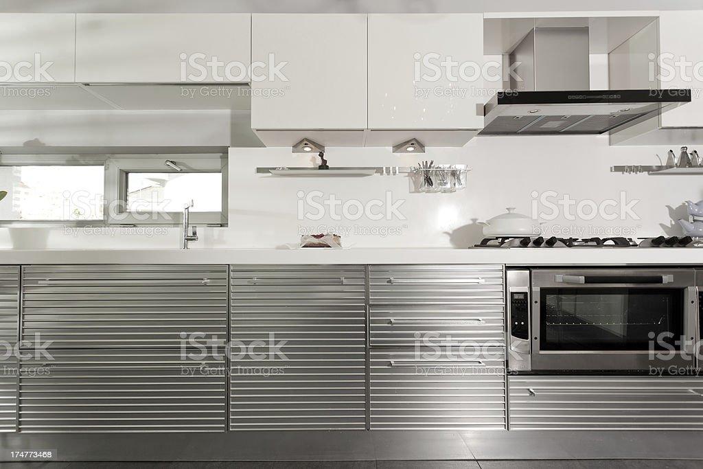 Modern white kitchen with stainless steel appliances stock photo