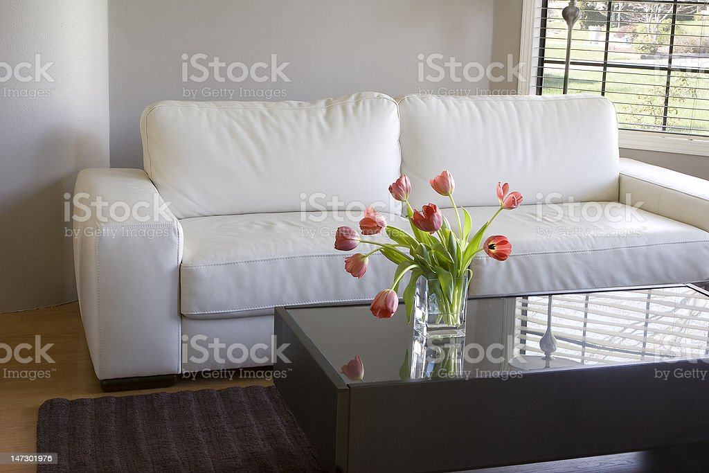 modern white living room with red tulips royalty-free stock photo