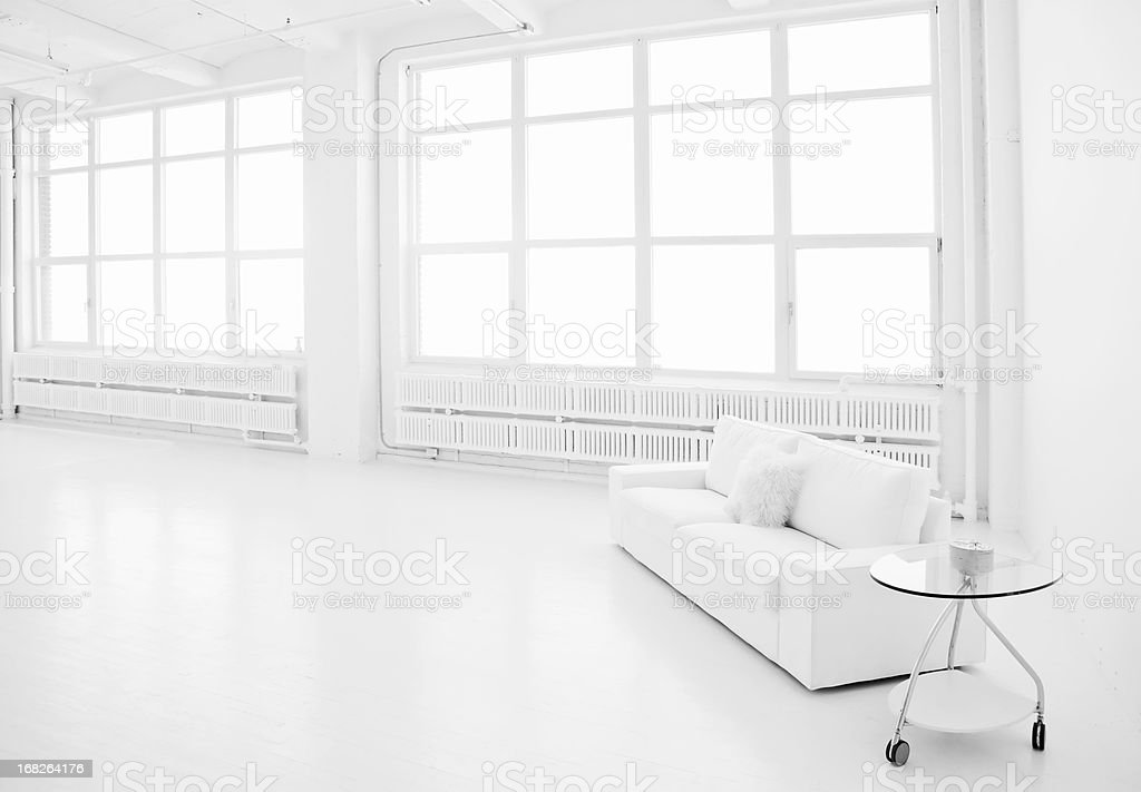 A modern, white loft living space stock photo