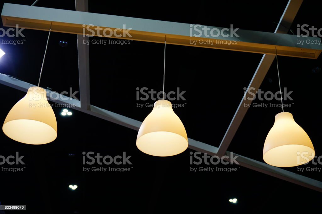 Modern white Metal Illuminated Lamps Hanging stock photo