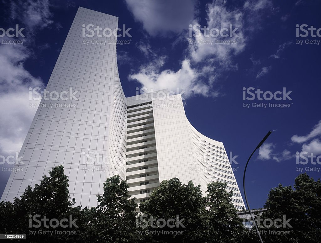 Modern white office building against blue sky. royalty-free stock photo