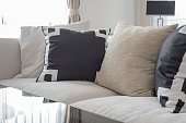 modern white sofa with black and white pillows