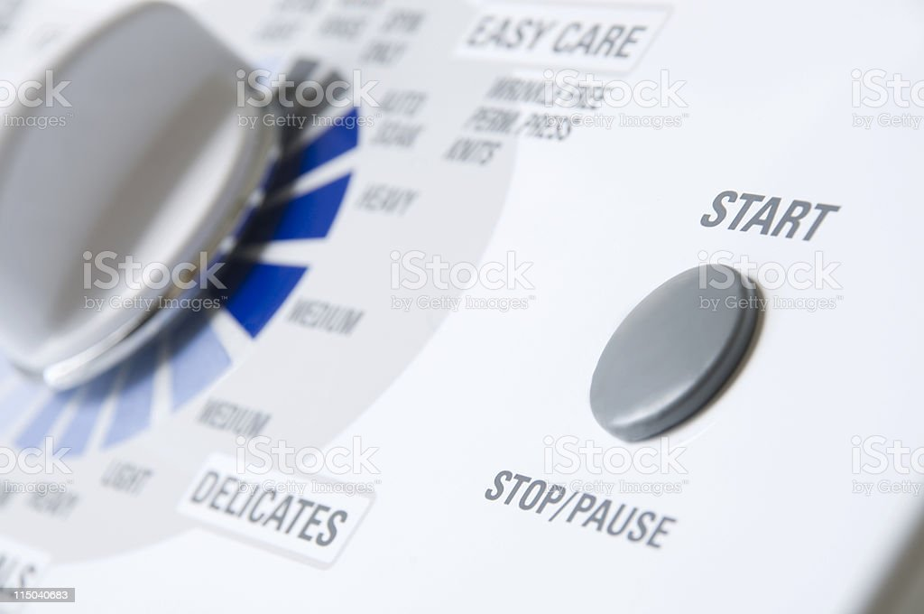 Modern White Washing Machine Appliance Start Button and Dial stock photo