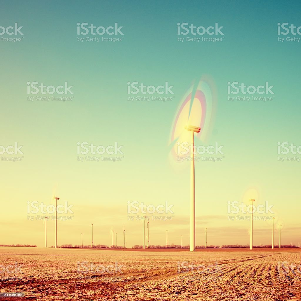 Modern Wind Turbines Producing Energy in suny spring morning. stock photo
