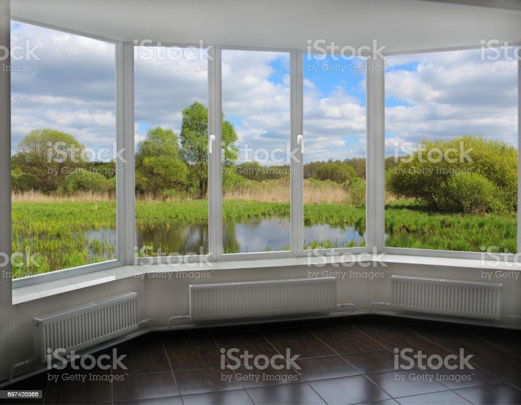 modern window to the summer bog stock photo