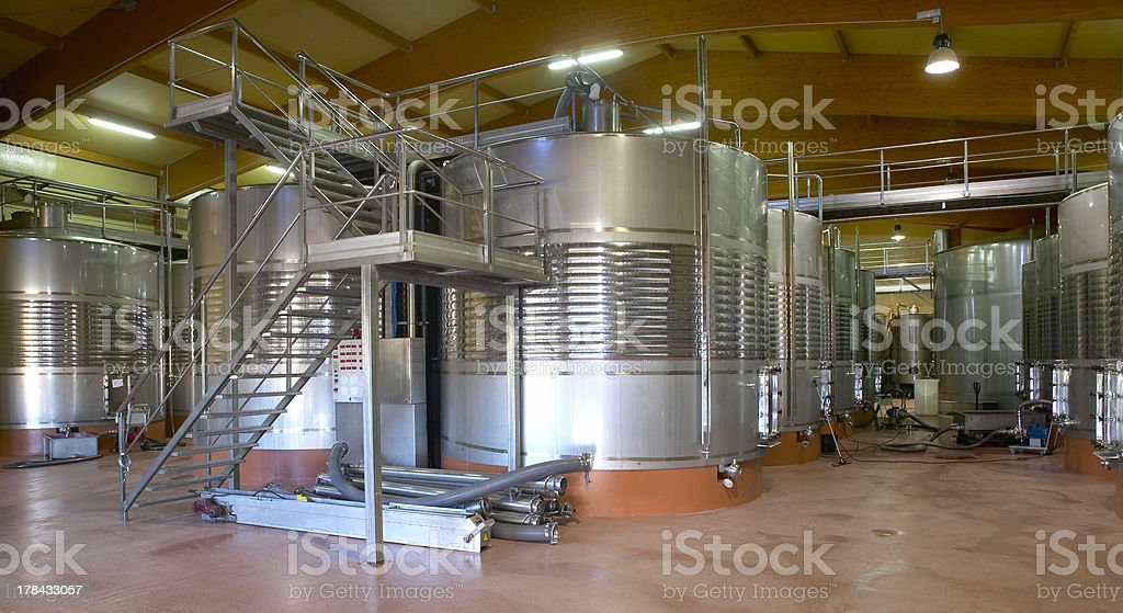 Modern winery fermenting process with new stainless steel stock photo