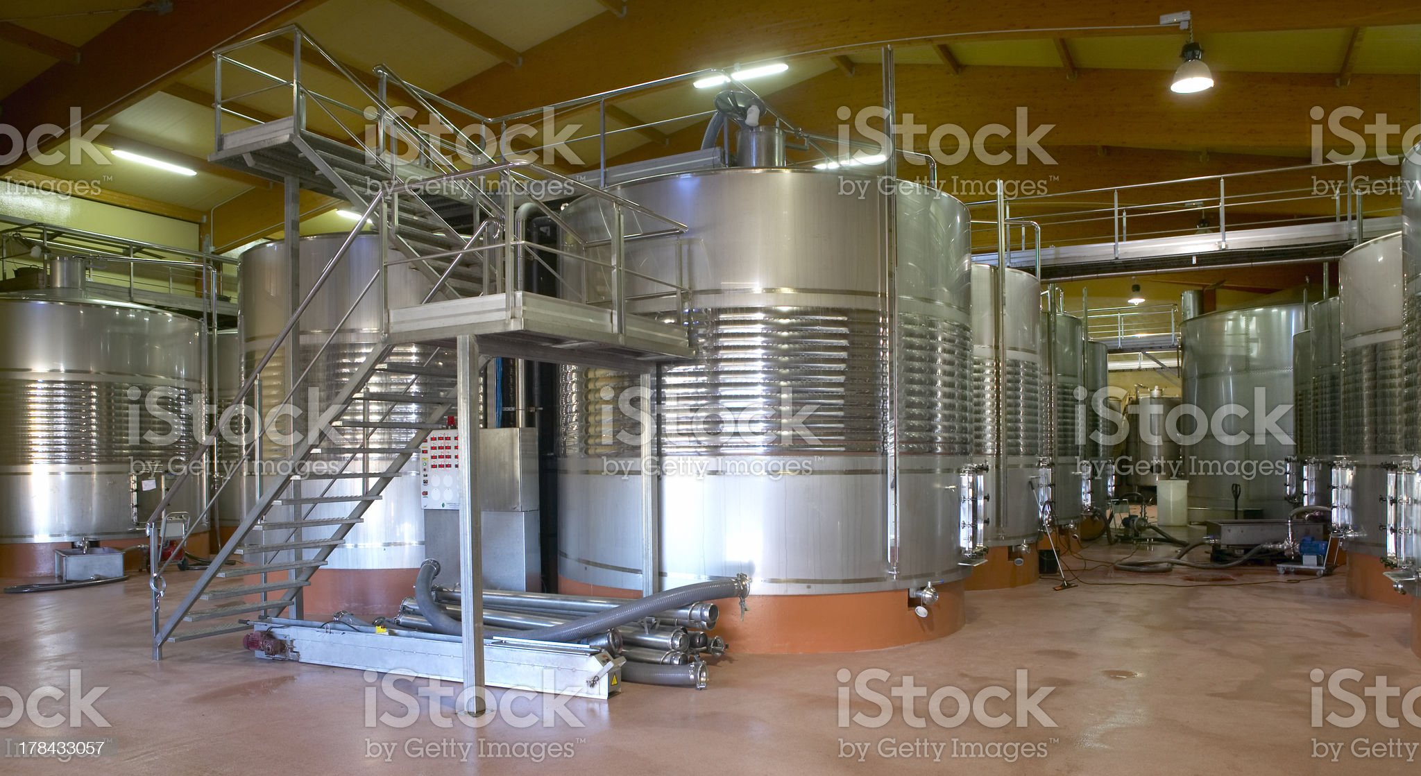 Modern winery fermenting process with new stainless steel royalty-free stock photo