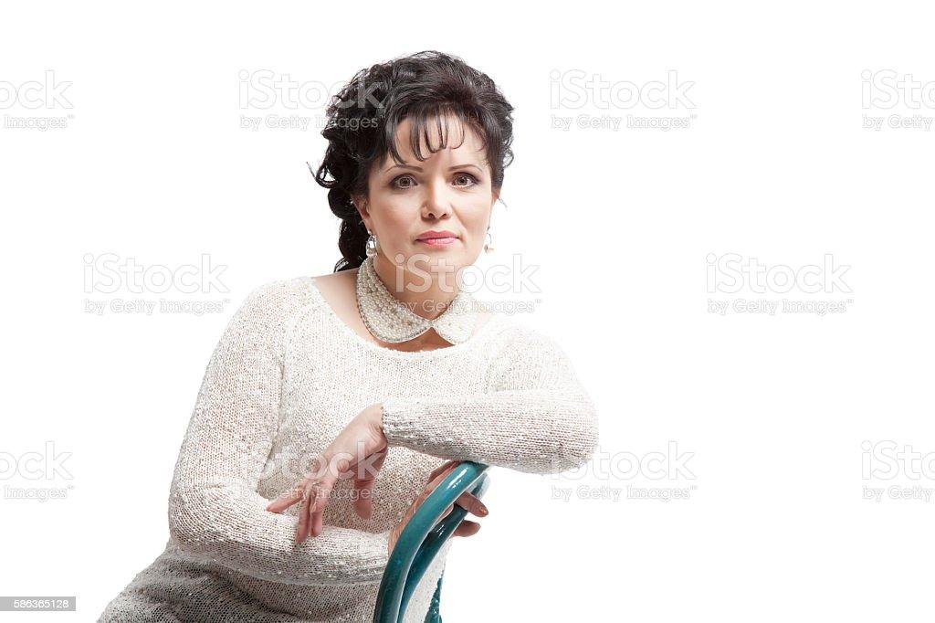Modern woman posing sitting stock photo