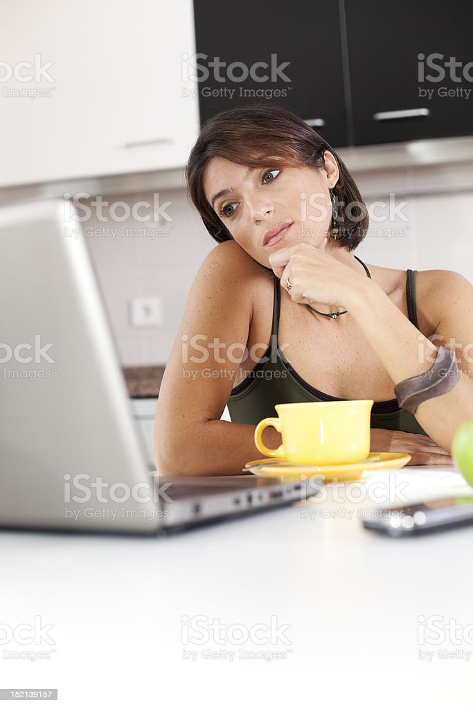 Modern woman reading e-mails at her breakfast royalty-free stock photo