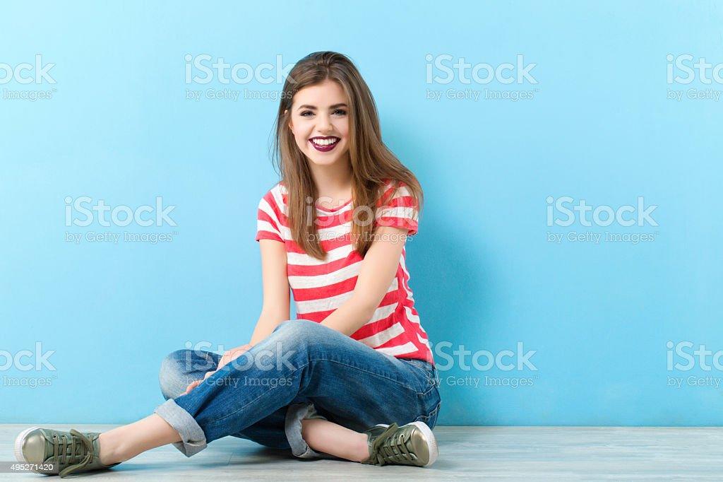 modern woman sitting on the floor stock photo
