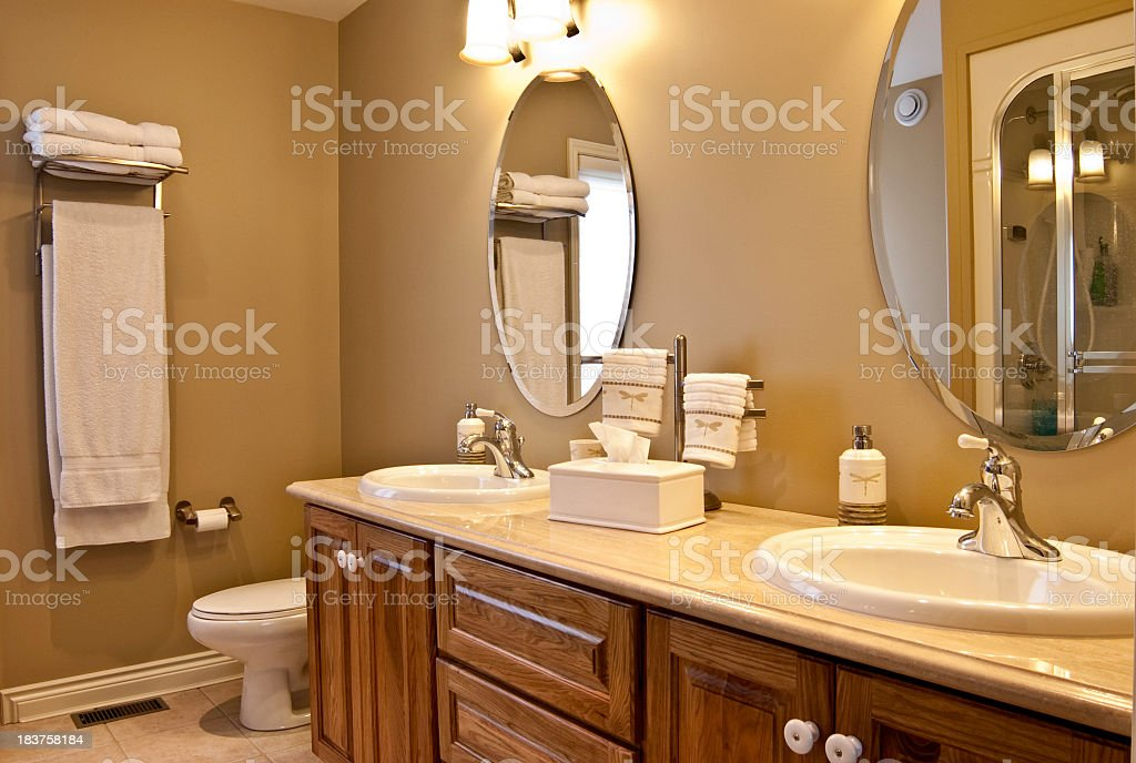 A modern wooden bathroom counter and mirrors royalty-free stock photo