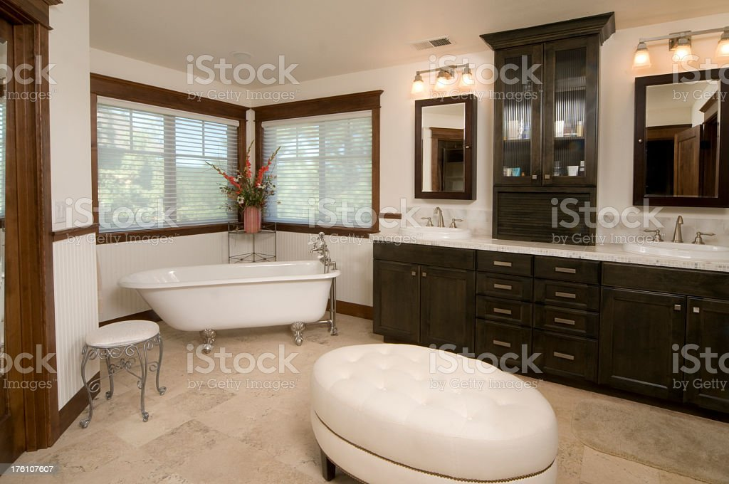 Modern wooden bathroom with free-standing bath stock photo